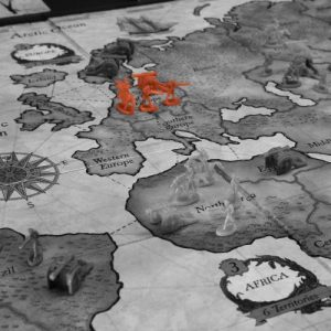 Risk Board With Orange Highlighted Pieces Representing Trust.