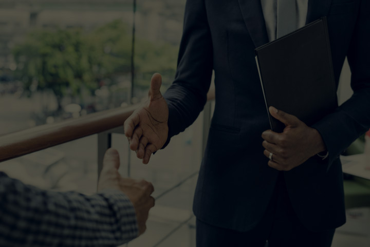 Businessmen Shaking Hands After Agreeing Their B-BBEE Contract.